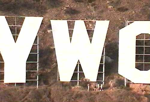 hikers walk alongside the huge letters